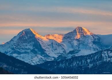 Stuuning view of Eiger North Face and Monch in Sunset from the lake side of the Thun lake, Canton of Bern, Switzerland