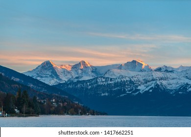 Stuuning view of Eiger North Face and Monch, jungfrau in sunset from the lake side of the Thun lake, Canton of Bern, Switzerland