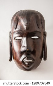 A styalized iron wood mask of a Massai warior, hand carved in Africa.