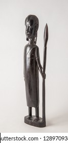 A styalized iron wood statue of a Massai warior, hand carved in Africa.