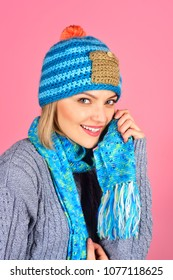 Style, autumn/winter fashion concept - cheerful girl in knit hat, scarf on neck, gray sweater. Beautiful caucasian girl with perfect skin and makeup. Smiling woman wearing warm scarf and hat.