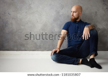a1de59a2 Style, fashion, people and men's wear concept. Portrait of fashionable  athletic adult bearded