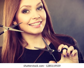 Style and fashion. Professional hairstylist barber with new idea of look changing. Long haired woman with scissors creating hairdo coiffure.