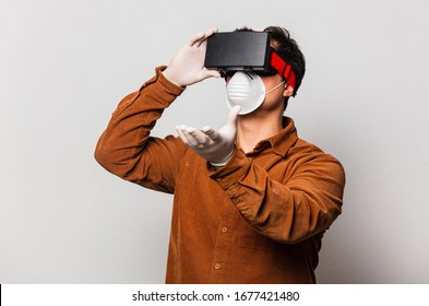 Style man in face mask and VR glasses on white background