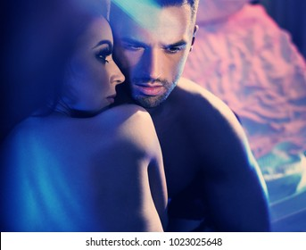 Styled art portrait of  sexy passionate couple hugging on bed