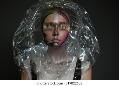 Styled Artistic Woman with Art Fancy Make-up. Vogue Style. Creativity