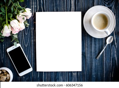 styled background with coffee, smartphote, roses and magazine co