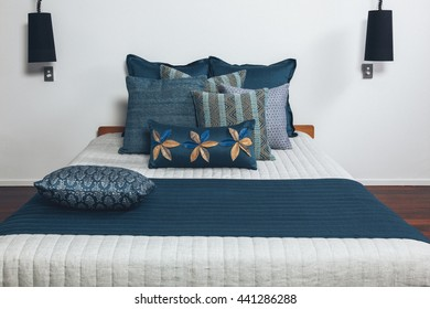 Styled bed in bedroom