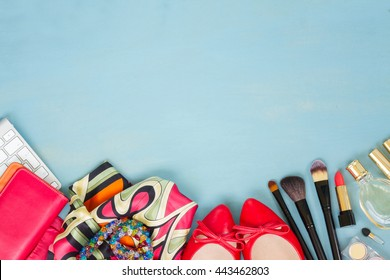 styled feminine desktop - woman fashion items on blue wooden background border with copy space