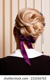 Styling. Rear View of Frizzy blond Hair Woman. Haircare Spa Salon Concept