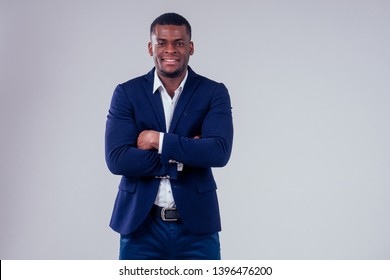 stylish african american in costume black pants and jacket with a big shirt collar posing in studio on white background