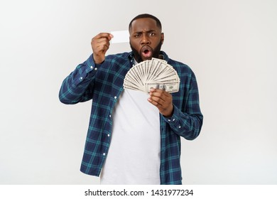 stylish african american in costume holding white credit card and money in studio on white background.