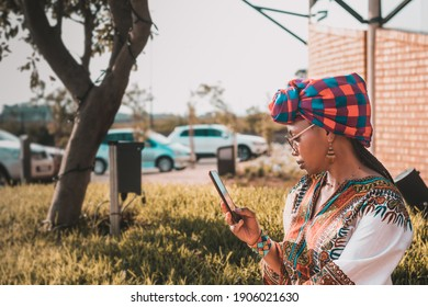 Stylish African lady using her mobile phone