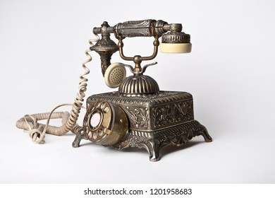Stylish antique looking vintage telephone isolated on white