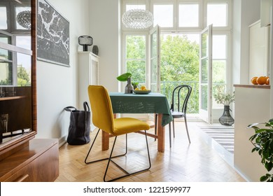 Stylish apartment decor idea, eclectic kitchen with balcony, real photo