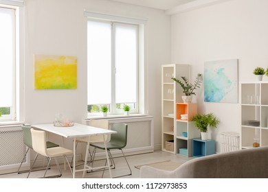 Stylish apartment interior with dining table and sofa