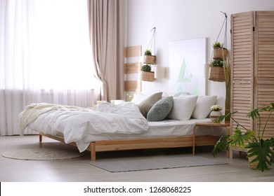 Stylish apartment with large comfortable bed. Room interior