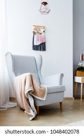 Stylish armchair in a bright cozy living room
