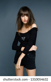 stylish attractive young woman posing in studio