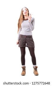 Stylish authentic hipster woman smoking rolled cigarette. Full body isolated on white background.