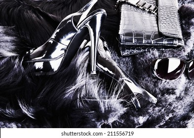 stylish background of shoes, clutches, sunglasses, fur.  black-and-white image in high contrast.horizontal