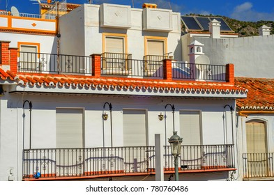 Stylish balcony with a metal railing, solid architectural element, a place of rest and relaxation, vintage decor, balcony