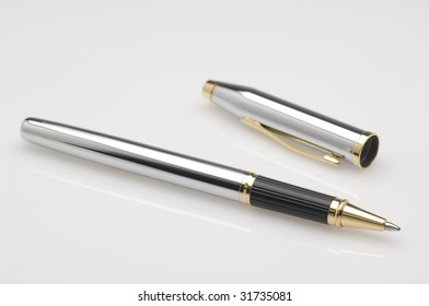 Stylish ballpoint pen with gold ornaments.