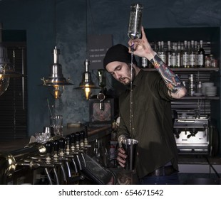 Stylish barman in action in a bar