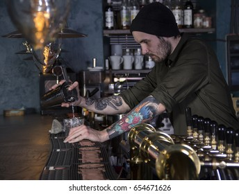 stylish barman serving the cocktail