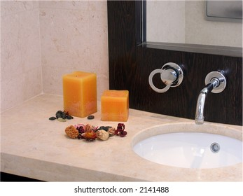Stylish bathroom with candles and potpourri