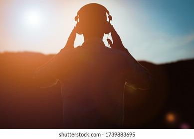 stylish bearded man in headphones listening to music