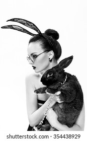 Stylish, beautiful girl model in an image of a rabbit