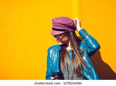 Stylish beautiful girl on yellow background
