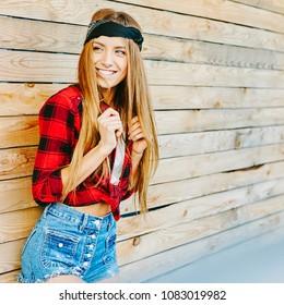 Stylish beautiful smiling woman outdoor portrait