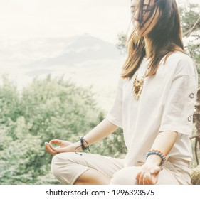 Stylish beautiful young woman practicing yoga in pose of lotus in summer forest outdoor.