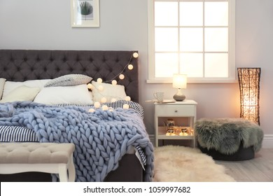 Stylish bedroom interior with comfortable bed