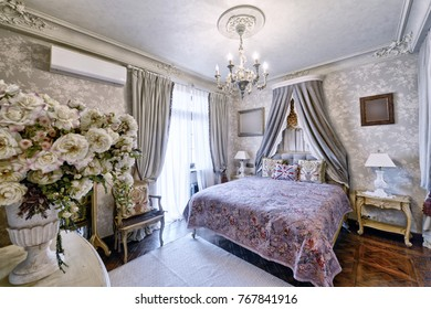 Stylish bedroom interior with double bed.
