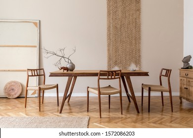 Stylish and beige interior of dining room with design wooden table and chairs, vase with flowers, elegant and rattan accessories. Korean style of home decor. Wooden parquet. Template. - Shutterstock ID 1572086203