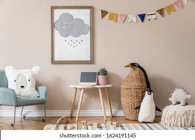 Stylish and beige scandinavian interior of kid room with mock up poster frame, design furnitures, natural toys, hanging colorful flags, plush animal and child accessories and teddy bears. Home decor.