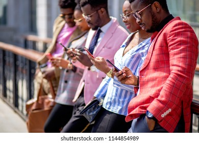 stylish bisiness people having a rest. modern african youth.side view photo