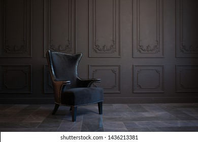 Photo of Stylish black chair against a dark gray wall. Stylish chair on wall background, copy space, fashionable interior