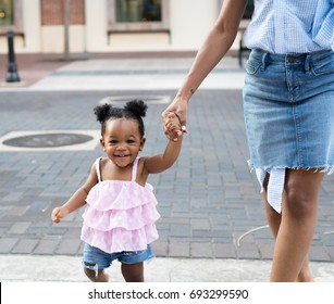 Stylish  black mom and daughter