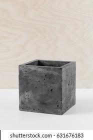 Stylish black pot of fibrous concrete for indoor plants