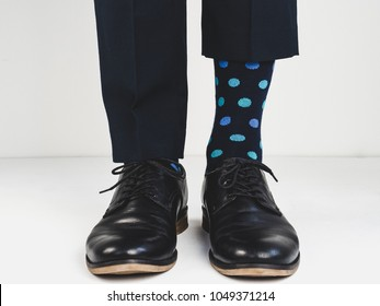 Stylish, black shoes and bright, happy socks on a white background. Style, fashion, beauty