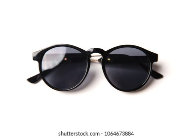 Stylish black sunglasses isolated on white background, top view