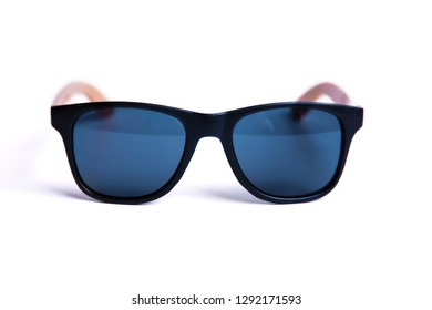 Stylish black sunglasses with wooden frames isolated on white background