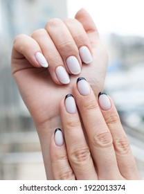 Stylish black and white manicure. The work of a manicure master. Beautiful minimalist design. Different designs on hands