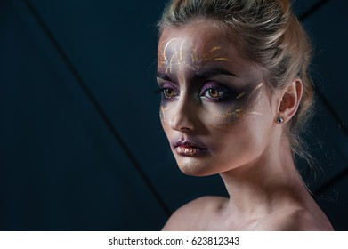 The stylish blonde with a bright make-up. Beauty Portrait of young beautiful girl. Perfect make-up. Perfect skin. Fashion photo