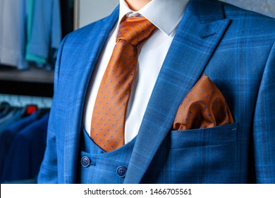 Stylish blue men's suit and white shirt with a brown tie. Male style. Close-up.