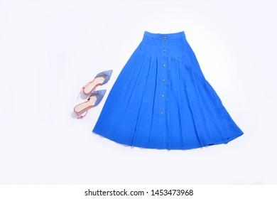 Stylish blue skirt with shoes isolated on white background